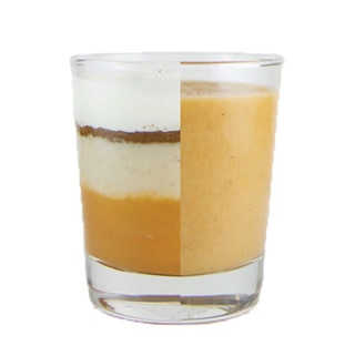 Clear cup half filled with ingredients for the puree and the other half of the cup is the homemade baby food puree.