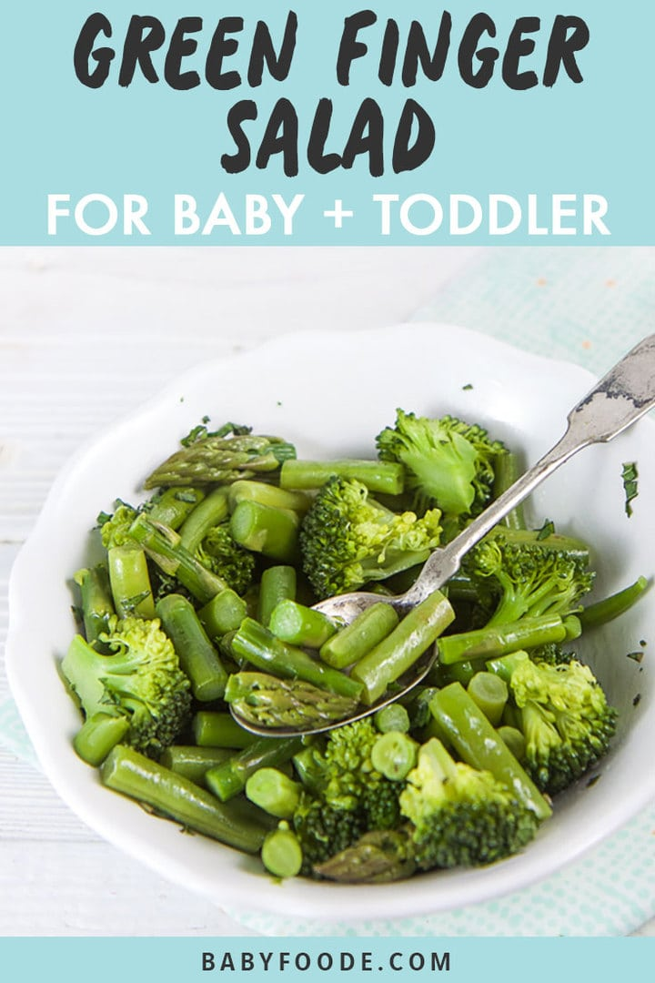 Graphic for Post - Green Finger Salad for Baby + Toddler. Image is of a White bowl filled with green veggies for finger foods or baby-led weaning.