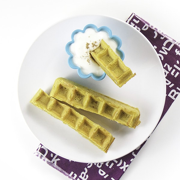 Pumpkin waffle dippers with greek yogurt for toddler breakfast idea.