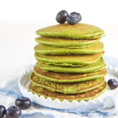 Stack of green spinach pancakes for baby and toddler.