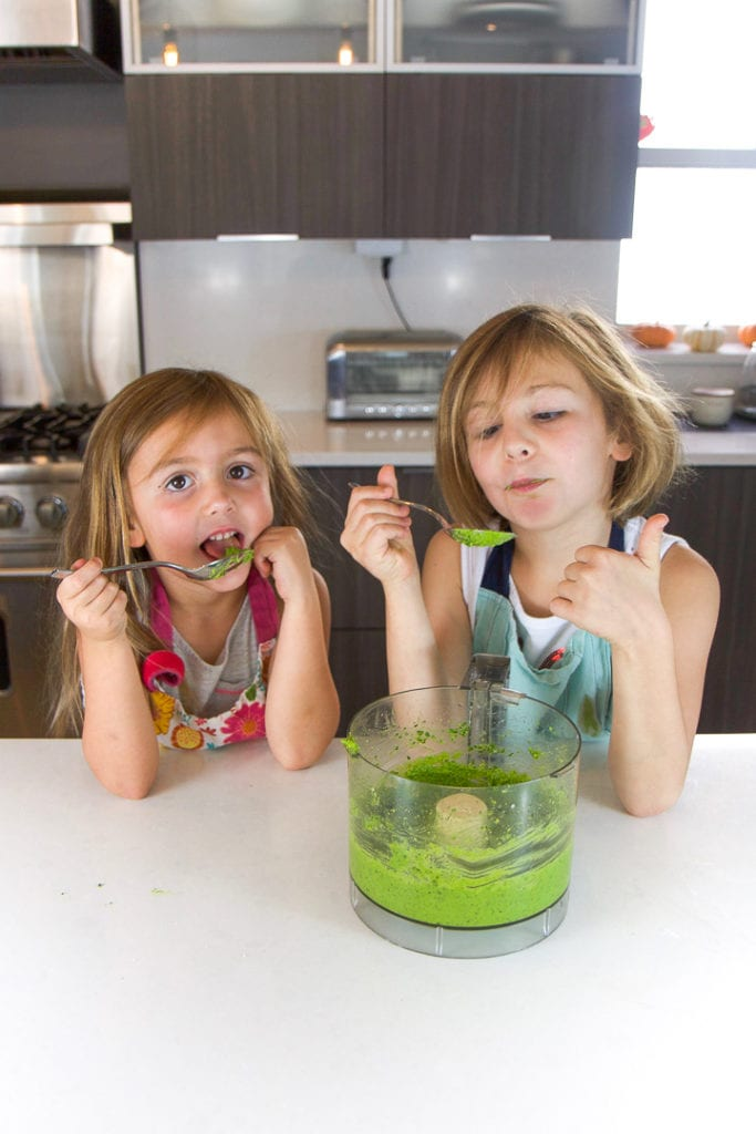 2 girls giving thumbs up for the recipe they made.
