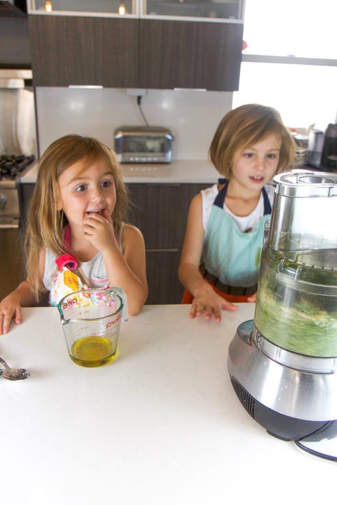 2 kids making a food recipe.