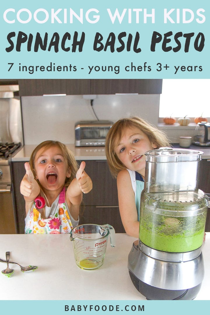 Graphic for post - Cooking with Kids - Spinach Basil Pesto - 7 ingredients - young chefs 3+ years. Image is of two girls in a kitchen, one make in the thumbs up sign.