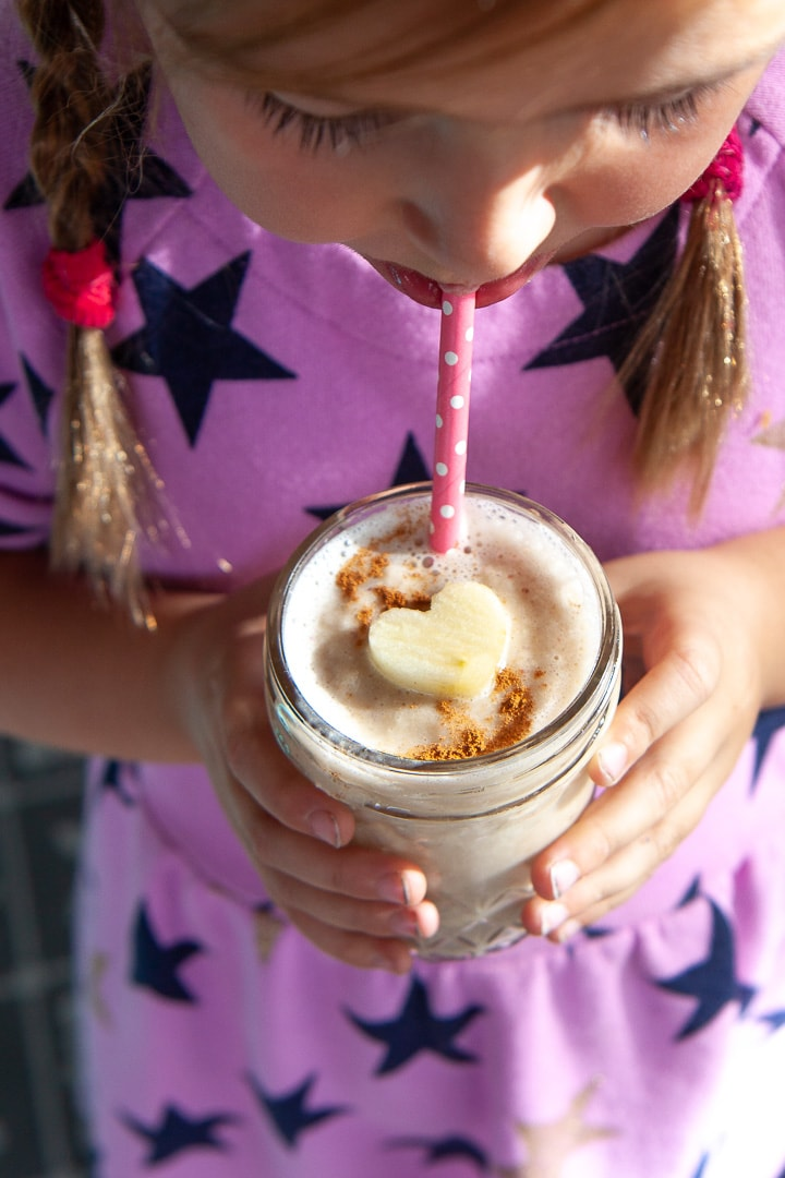 Girl holding an apple pie smoothie.
