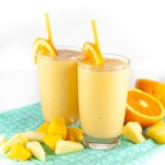 two toddler or kid smoothies with citrus fruit around it for toddler and kids