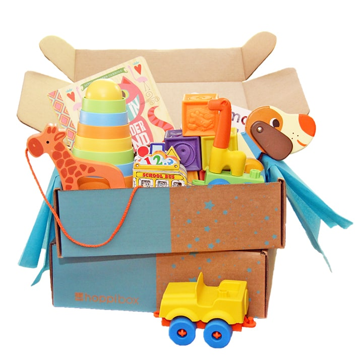 Hoppi Box - a box opened and bursting with toys and books for baby.