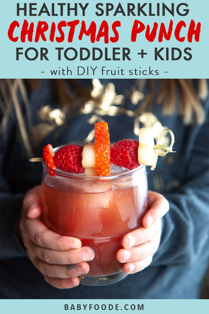 Graphic for Post - Healthy Sparkling Christmas Punch for Toddler + Kids.- with DIY fruit sticks with image of Small girl holding a glass of healthy Christmas punch