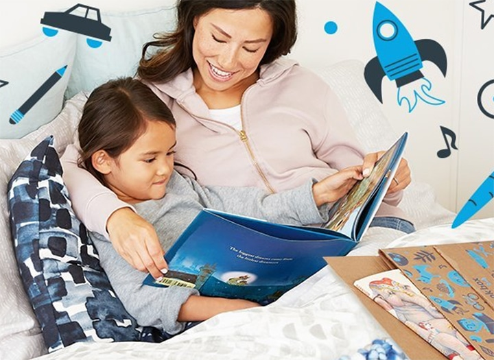 Amazon Book Box - a mom and child snuggling while reading a book