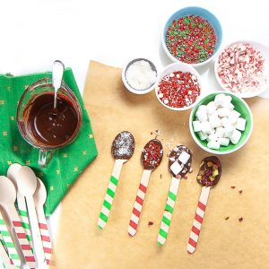 Spread of process of how to dip spoons and add toppings.