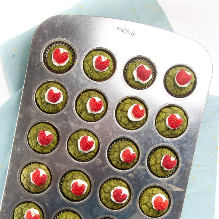 Full pan of cooked and decorated Grinch Mini Muffins for Baby and Toddlers.