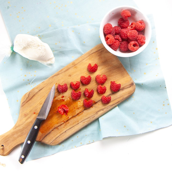 Raspberries cut into heart shapes.
