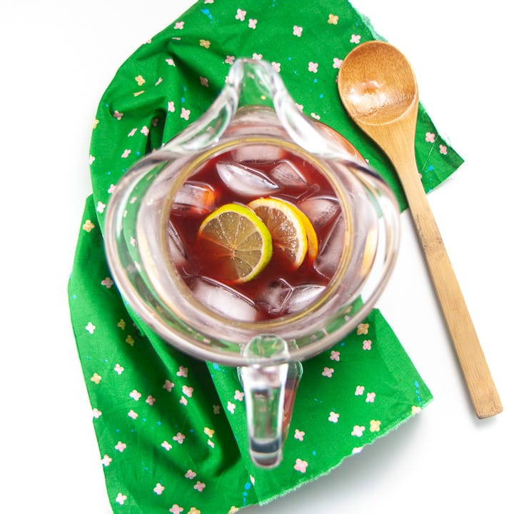 Clear pitcher with juice, ice and fruit for chirstmas punch