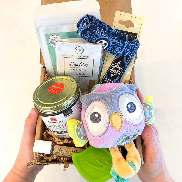 Ecocentric mom subscription box - box filled with baby and mom gifts.