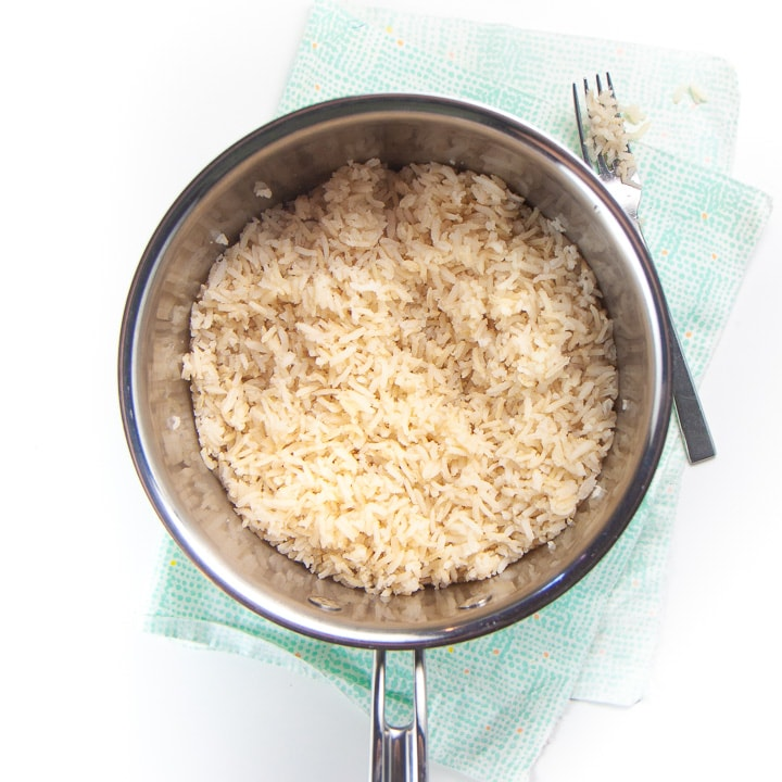 saucepan filled with cooked rice