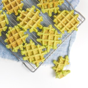 Spinach waffles for Baby led weaning on a cooling rack.