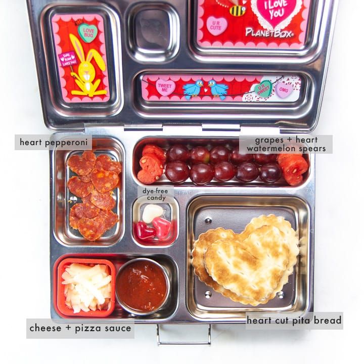 School lunch box with healthy diy heart pizza punchable with all foods labeled.