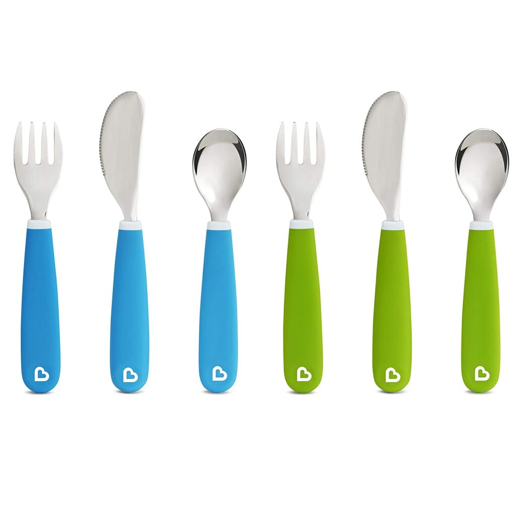 toddler utensils with teal and green handles.
