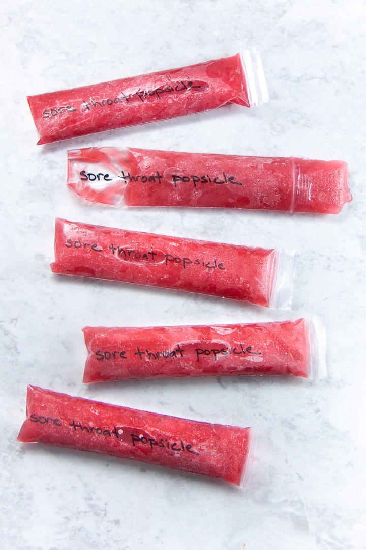 Popsicles scattered on a backdrop.