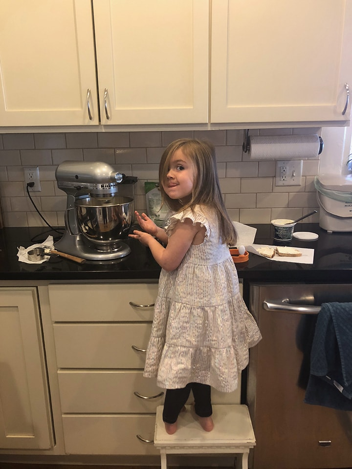 girls baking at home for an easy toddler and kid project.