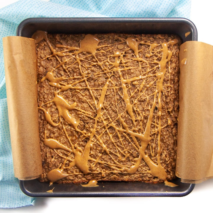Banana peanut butter oatmeal bake with swirl of peanut butter on top.