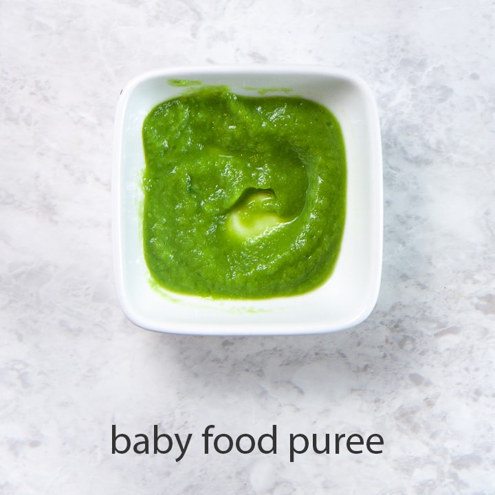 bowl of green bean puree for baby first food.