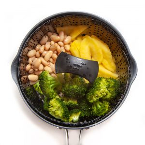 steamer pot with full meal for baby - broccoli, apple and white beans.