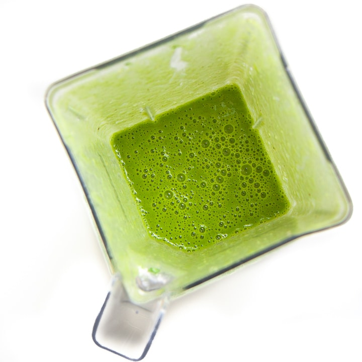 Green smoothie popsicles in a blender all blended up.
