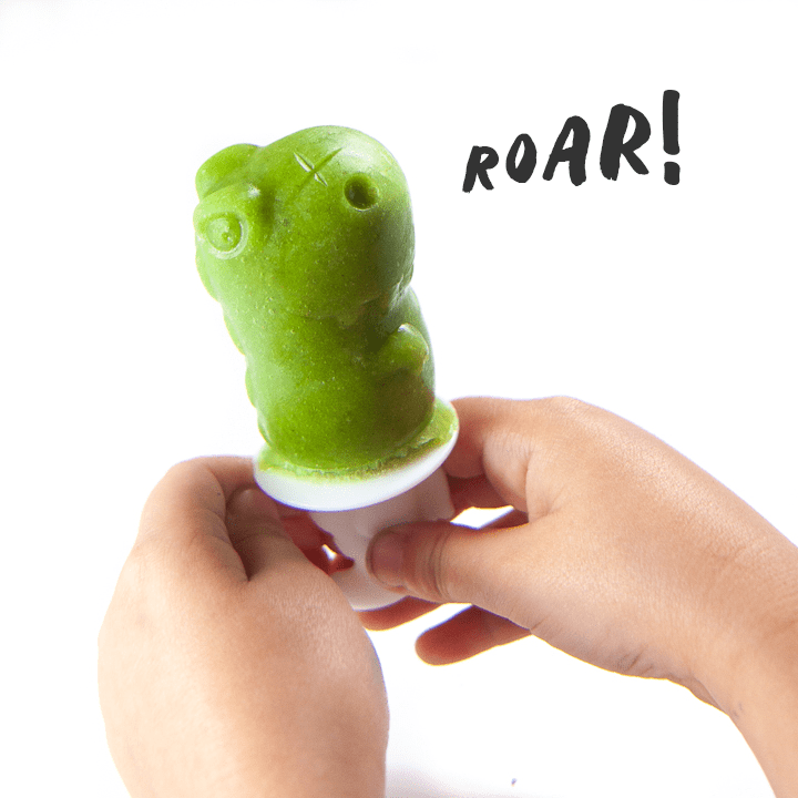 Green smoothie popsicle of a Dino roaring