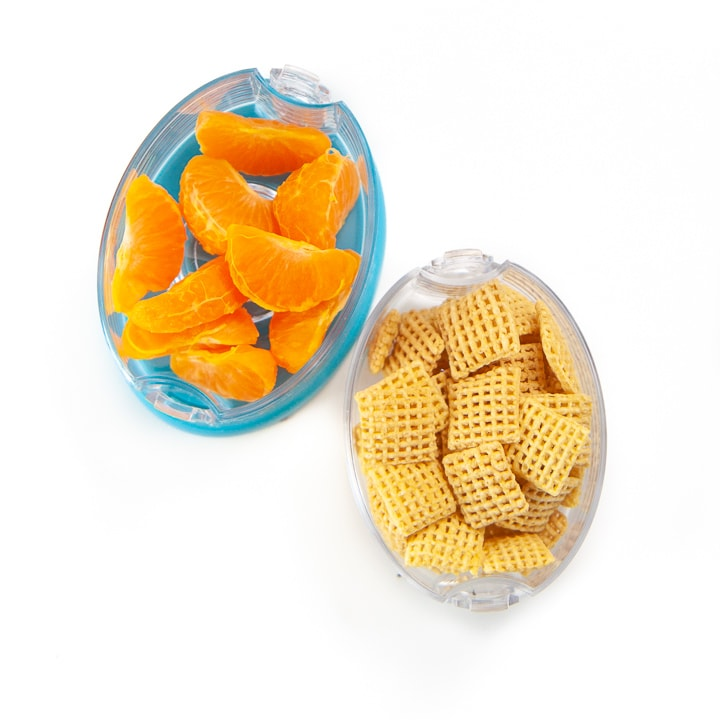 2 snack cups filled with cereal and orange sections.