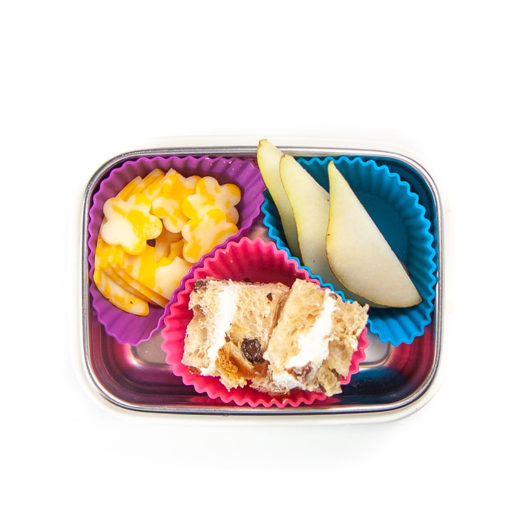 Travel snack container for toddler or kids filled with healthy foods.