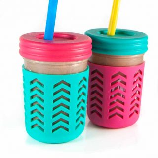 2 smoothie cups filled with a hidden veggie smoothie for kids and toddlers.