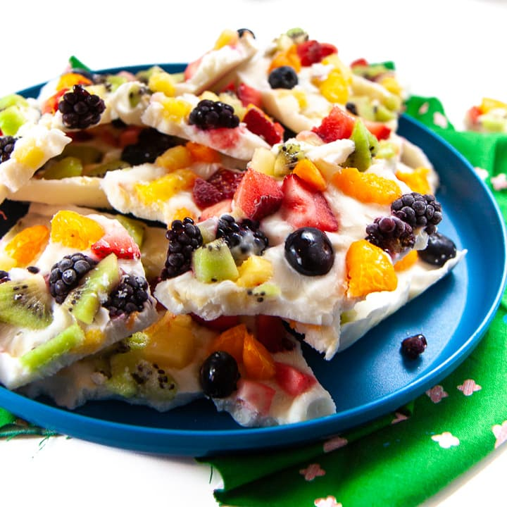 Rainbow yogurt bark on a plate ready for toddler and kids.