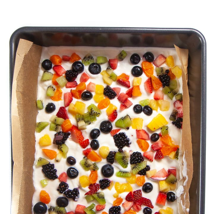 Rainbow yogurt bark in a baking dish.