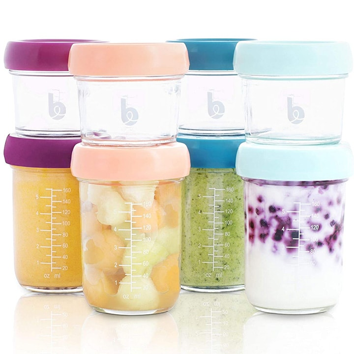 Set of 8 glass jars for storing baby food purees.