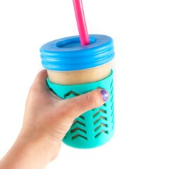 Hands holding up smoothie cup.