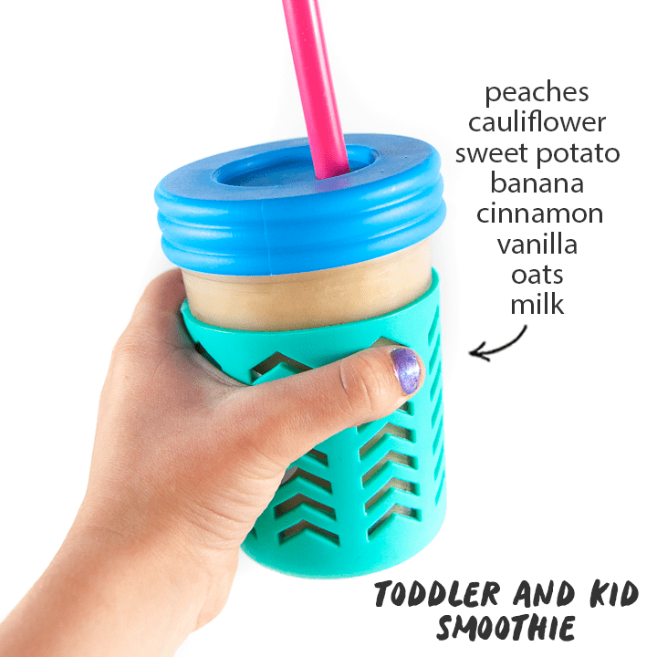 hidden veggie smoothie for kids with kids hands holding the cup with a list of healthy smoothie ingredients on the side.