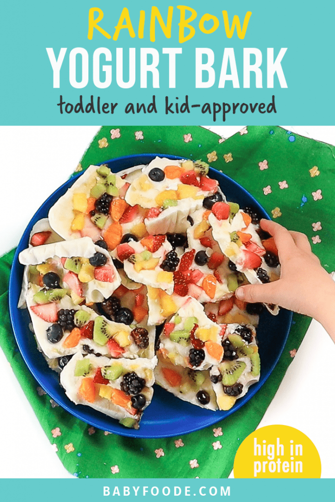 Graphic for post - rainbow frozen yogurt bark - toddler and kid favorite - high in protein. Image is of kids hand reaching into a pile of frozen yogurt bark.