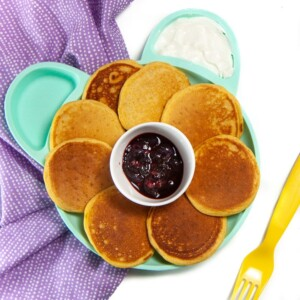 Plate full of baby-led weaning pancakes with dips.