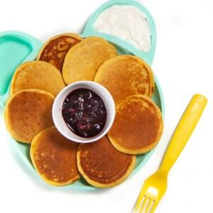 Baby plate full of sweet potato pancakes.