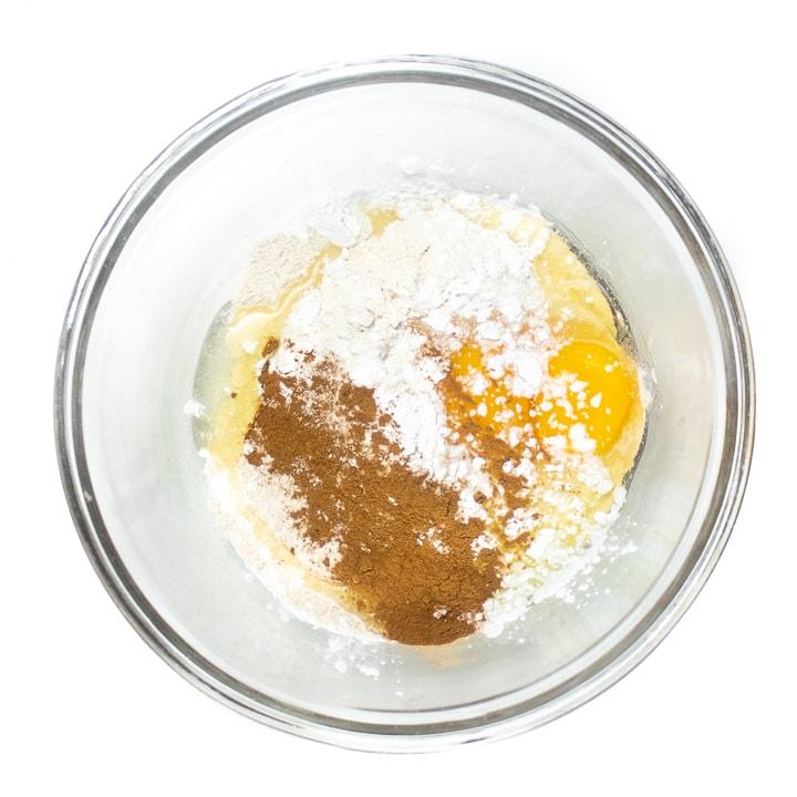 Bowl full of ingredients for pancakes.