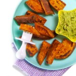Plate full of sweet potato wedges for baby with a fun dip.