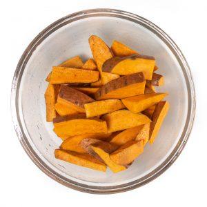 Bowl full of sweet potato wedges for baby.