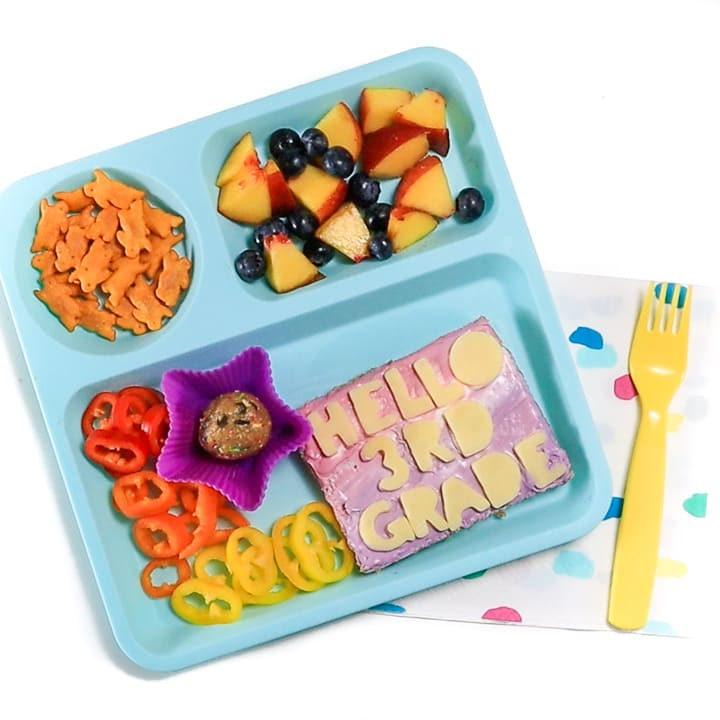 first day of school lunch for kids on a teal plate for home.
