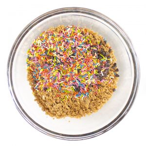 bowl of ingredients for energy balls with sprinkles and chocolate chips.