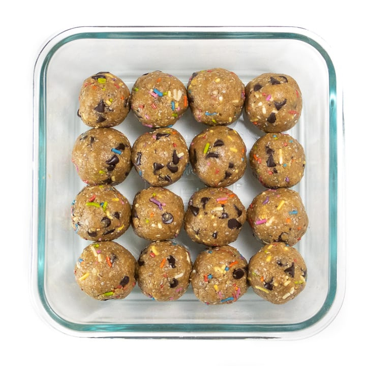 funfetti energy balls in a storage container.