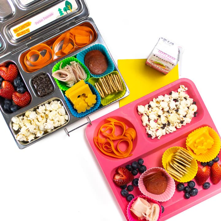 Homemade lunchables for kids in a bento school lunch box as well as a plate for home lunch.