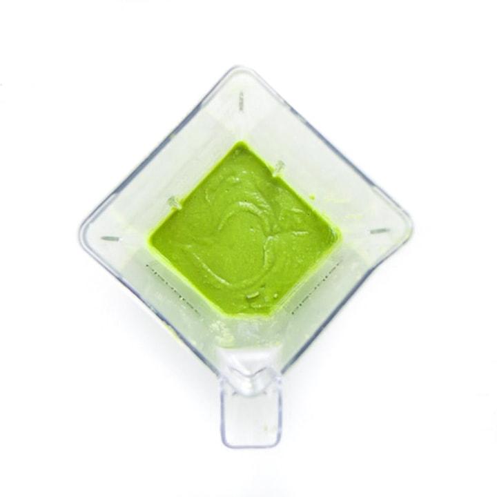 Blender full of blended green puree.
