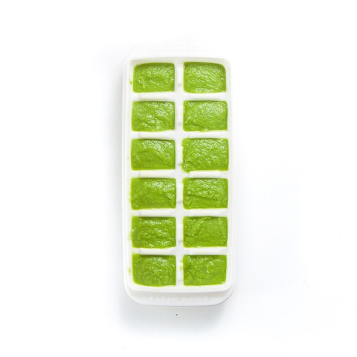 White freezer tray filled with green bean puree.