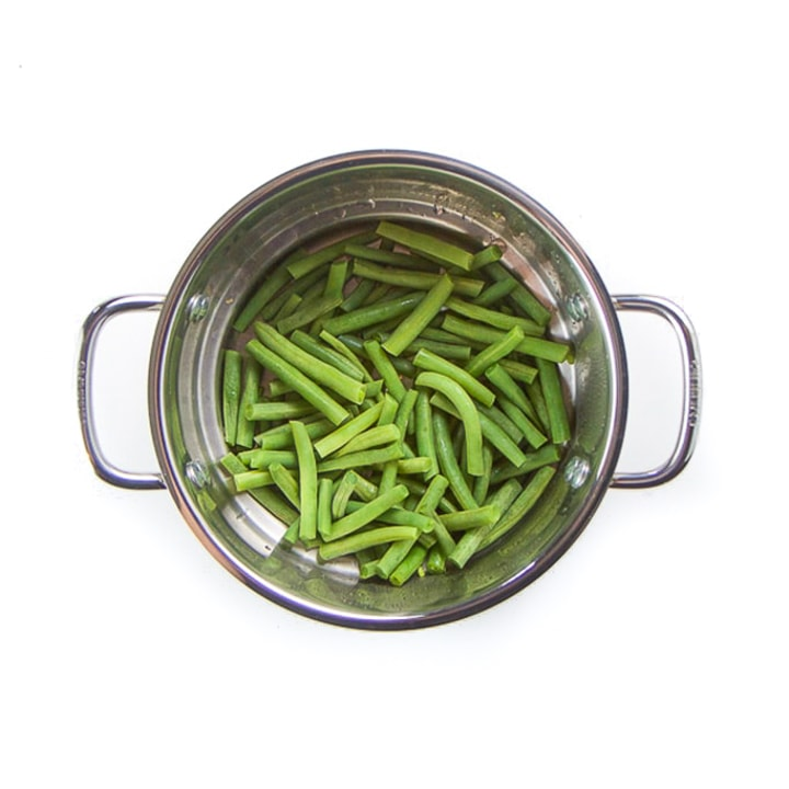 Steamer basket with green beans.