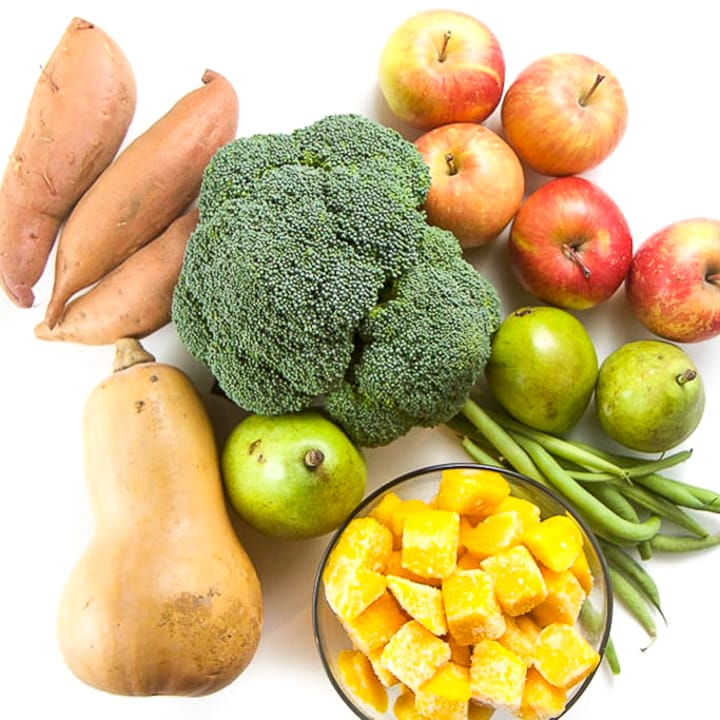bunch of produce in a pile on a white background.